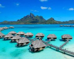 Four Seasons Resort Bora Bora, French Polynesia    Spacious suites on stilts are ideal for taking in the turquoise lagoon and white sand beaches at this decadent tropical hideaway, which overlooks the verdant Mount Otemanu.