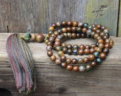 Mala necklace made of 108, 8 mm - 0.315 inch, beautiful labradorite gemstones, decorated with agate, hematite, jasper and the guru bead is a faceted agate stone.  The total length of the mala necklace is approximately 101 cm - 39.76 inch.