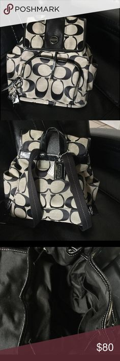 "Authentic Coach signature stripe backpack Authentic COACH SIGNATURE STRIPE BACKPACK STYLE: F21928 COLOR:black/grey 10 3/4"" (L) x 11 1/2"" (H) x 4 3/4"" (W) Outside clean.  Inside minor soiling. No rips tears or odors.  Comes with 2 hangtags and keychain Coach Bags Backpacks"