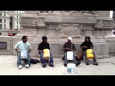Bucket boys drumming on the Magnificent Mile (Chicago, IL)
