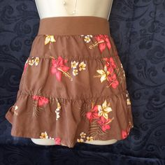 One * Step Up Miniskirt Size Medium This beautiful brown miniskirt by One Step Up is in the size medium.This cute skirt has lots of stretch. The measurements are waist 17 and waistband to bottom skirt is 13. Sorry no trades One*Step Up Skirts Mini