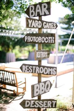 DIY Backyard BBQ Wedding Signs out of reclaimed wood / http://www.deerpearlflowers.com/barbecue-bbq-wedding-ideas/
