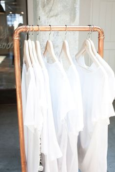 hang clothes on a copper pipe rack