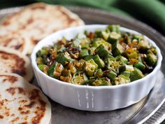 This crispy pan-fried okra is a popular Indian recipe also known as bhindi. It's a delicious way to eat okra! Recipe by Ashley of MyHeartBeets.com