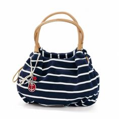 Anchors Away Brewster Hobo, Nautical navy with white stripes on canvas, neutral handles, hanging red and white anchor charm, sets the theme for Spring and Summer, Brighton