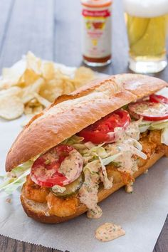 "Shrimp Po' Boy - Crunchy, flavorful fried shrimp and a tart, smoky remoulade ""dressed"" with lettuce, tomatoes and pickles all between a plush roll with a thin crisp crust."