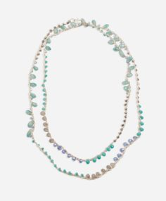 Sparkling thread is intertwined with metal chain and delicate glass beads in icy hues.