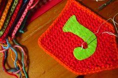 Adding felt letters to crochet pieces
