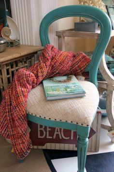 Gorgeous throw with corals and a touch of teal.