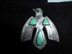 Fred Harvey era thunderbird brooch, with turquoise