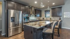 Shades of gray define this inviting kitchen. The Horizon plan, a new home from Mandalay Homes. The Cathedral Point at The Dells community. Prescott, AZ.