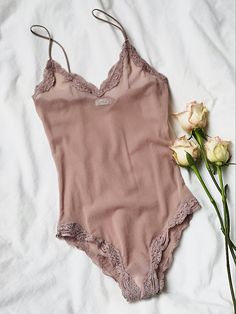 Brazilian Body Suit   American made mesh bodysuit featuring a V-neckline and delicate lace trim.