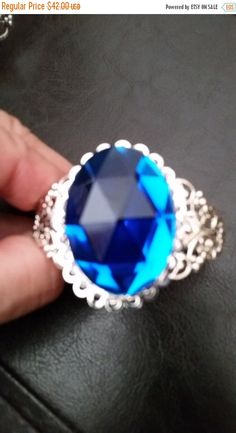 ❘❘❙❙❚❚ ON SALE ❚❚❙❙❘❘     Gorgeous Royal Blue Fashion Cuff Bracelet--Lacey Style in Gunmetal Gray...just Gorgeous!  Fits size sm-lg sizes...(not ex sm or ex lg)...  Offered at Low price...    FREE Gift wrap all jewelry and jewelry related items.    Specials:     20-25% off Jewelry SALE...    FREE Shipping on 2nd thru 8th jewelry items when purchased within 24 hrs of 1st purchase.    Thanks for visiting our Site here on Etsy. Happy Shopping for what you love...    NOTE TO BUYERS:  I would…