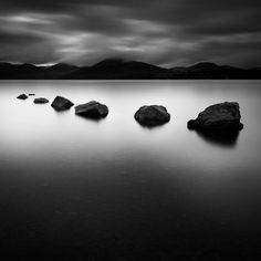 Rocks in the water. Zen and minimalist photography.
