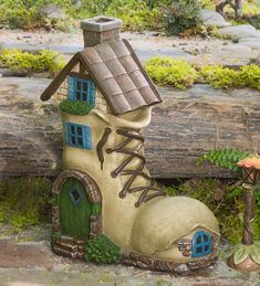 Miniature Fairy Garden Boot Home has a found look that's perfect for your fairies. Great detail lends a special look to your miniature or fairy garden. Stone foundation, windows, painted door and chimney - it's everything a fairy looks for in a good home :)