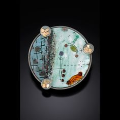 Anne Havel - nuclear series: atomic orbit pin/pendant - brooch/pendant. torch-fired vitreous enamel on copper. enamel techniqes: sgrafitto, painted, sifted, wet-packed, fused, over-fired. approx 10 firings. fabricated, formed, soldered, back-tab & frame set, oxidized. 14kt, rust, firescale, sterling, copper