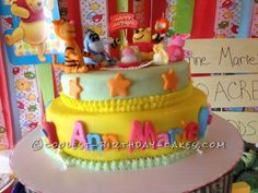Winnie the Pooh 1st Birthday Cake... This website is the Pinterest of birthday cake ideas