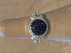 Same ring, but instead of a Pearl center, put a Black Sparkle in the center!  2 looks in 1 ring!  That's how we make jewelry practical....