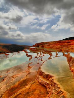 Badab-e Surt, Iran |   Badab-e Surts terraces are made of travertine, which is a sedimentary rock deposited by flowing water from two distinct mineral springs. Thousands of years the water from these two springs had been streaming down from the mountain, it mixed up and gradually created a number of orange, red and yellow colored pools which now have the form of a staircase.