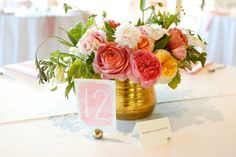 Bright and colorful wedding centerpieces paired with watercolor table numbers. | Fairy Tale Photography
