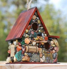 bird house mosaic with found objects