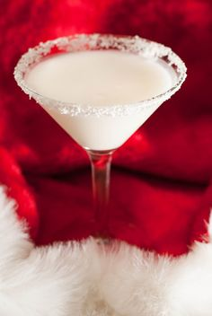 Two Turtle Doves Cocktail: 1 1/2 oz vodka, 1 oz coconut cream, 1 oz half and half, 1/2 oz white creme de cacao, and grated white chocolate.