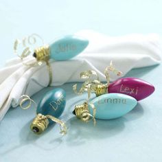 Great DIY holiday idea: paint old Christmas bulbs and write names on them. Great for place cards or as a gift tag.