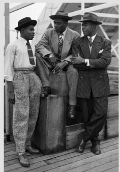 Malcolm X (1925 –1965) (in the middle) in ZOOT SUIT. He was an African-American muslim minister and an influential human rights activist.