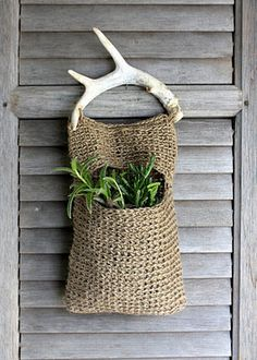 Jute and Antler Plant Hanger-This bag is actually crocheted but I would knit one instead.