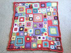 Babette blanket with all sorts of colors from Granny squares. I have to learn how to alternate colors next!