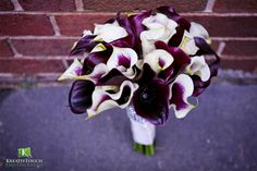 Hand tied bridal bouquet of eggplant and Picasso calla lilies for a wedding at the Old Courthouse on the Square in Decatur, GA