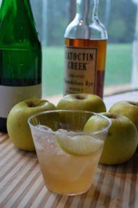 """Johnny Appleseed""  2 oz Catoctin Creek Organic Roundstone Rye  Castle Hill Celestial sparkling cider  Dash of Peychauds bitters  1 tsp superfine sugar    Fill a shaker with ice.  Add the rye, sugar and bitters, and top off with cider.  Shake well (holding tightly, since the carbonated cider will be under pressure!), and strain into a tumbler full of ice.  Serve with a slice of apple."