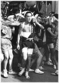 Yukio Mishima in the Summer Festival of Kumano Shrine, Meguro, Tokyo. August 19, 1956.