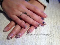 Some Tiny little flowers... On acrylic nails. Love