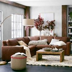 Henry 3-Piece L-Shaped Sectional from West Elm. This is the leather but also look at the fabric style (I will pick the right fabric)