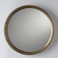 The Higgins Mirror features smooth, elegant lines with a round shape, curved rim and pencil-polished edges. Comes with keyhole hanger for easy wall mounting. Ha