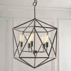 "With geometric flair, this modern metal industrial chandelier draws attention. Multi-faceted, literally and figuratively, shape transcends design genres. Available in Gray or Antique Brass. 5x40 watts medium base socket max. (bulbs not included).(35""Hx21""W)6' of chain."