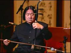 Master musician Xiao Bai-Yong plays the Erhu, a traditional Chinese bowed string instrument.