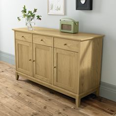 Shaker Oak Wide Sideboard featuring 3 dovetailed joint  drawers and 3 cupboard. Visit http://solidwoodfurniture.co/product-details-oak-furnitures-5230-shaker-oak-wide-sideboard.html