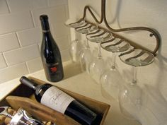 Juxtapose elegant glassware with this rustic, utilitarian idea from Dana Pugh. Simply remove the handle from any metal rake, and then anchor the head directly to the wall with screws. Flip each glass upside down and slide the stem between two prongs. Or, instead, use the rake to hang spatulas, wooden spoons or other kitchen utensils.