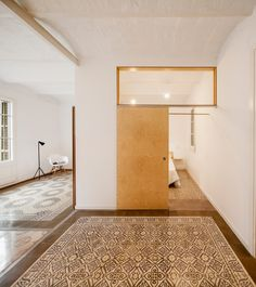 Patterned floor tiles mark out the original layout of this apartment in Barcelona, restored by local architecture student Adrian Elizalde. Apartment Renovation, Small Spaces, Renovations, Apartment, House Design, Interior, Beautiful Apartments, Barcelona Apartment, Interior Architecture