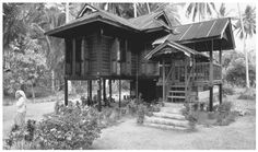 Malaysia - A house on Langkawi Island. Land ownership is a controversial issue in Malaysia, where indigenous groups are struggling to protect their claims from commercial interests. Asian Architecture, Vernacular Architecture, Pole House, Village Houses, Rural Area, Thai Style, Wooden House, Abandoned Houses, Cityscapes