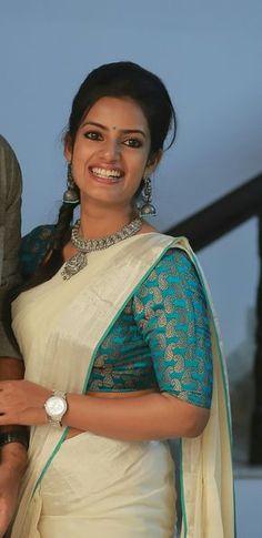 Kerala saree. Silver zari. Silver temple jewellery. Brocade blouse.