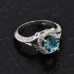 Tied at 2nd choice. Gold Halo Ring by CaliRoseJewelry on Etsy https://www.etsy.com/listing/211008423/aquamarine-ring-white-gold-diamond