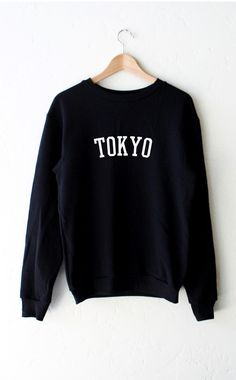 "- Description Details: Black oversized unisex fit sweatshirt with print featuring ' Tokyo' by NYCT Clothing. Unisex, oversized/loose fit. Measurements: (Size Guide) XS/S: 38"" bust, 27"" length, 25"" sle"