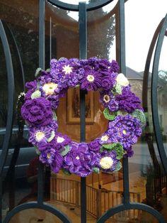 Spring Crocheted Wreath - Imgur via reddit:  http://www.reddit.com/r/crochet/comments/ubsak/spring_has_sprung_time_for_a_crochet_flower_wreath/