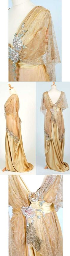 Evening gown, circa 1912. Silk satin and chiffon. Lace and glass beads.