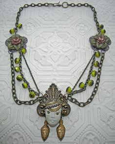 """For BSue's Boho Vibe group - """"Asiana"""" necklace with polymer face and vintage brass elements.   From artist Laurel Steven."""