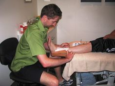 Special interest in sports injury prevention and treatment. Jason is seen here applying strapping tape to a sprained ankle of a netball player