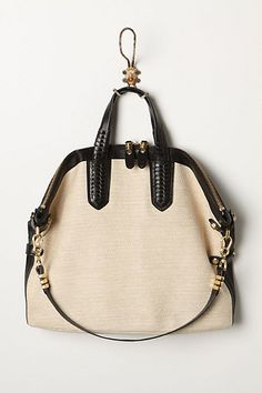 I love the front of this purse (the back is solid black leather though)